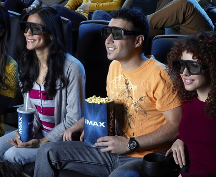 young adults at IMAX theater wearing 3D glasses