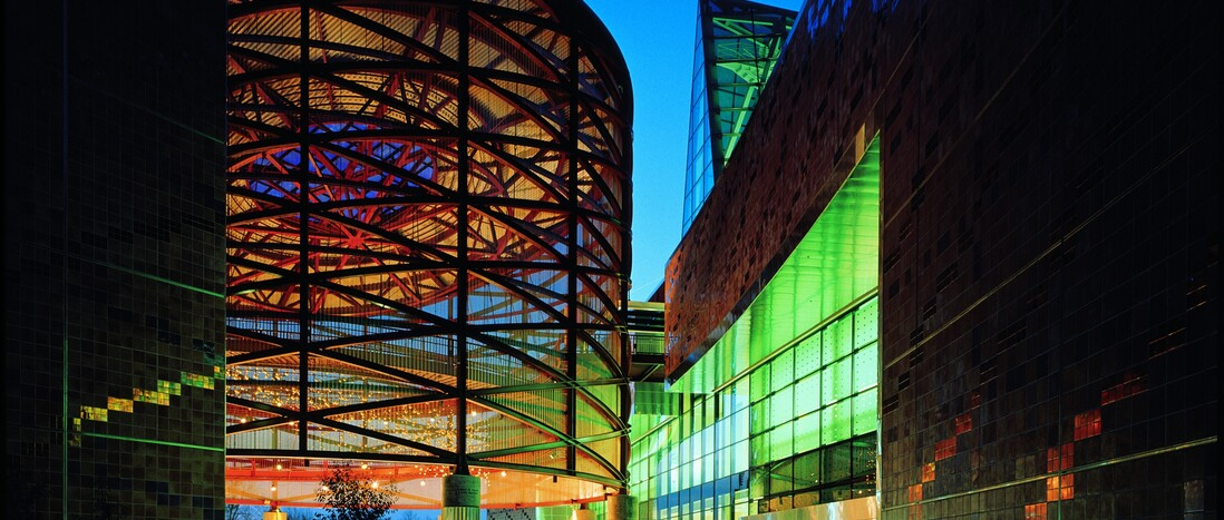Empty Lorsch Family Pavilion, California Science Center front entrance, dramatically lit at night